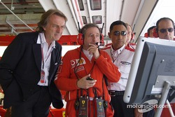 Luca di Montezemelo and Jean Todt watch Michael Schumacher qualifies