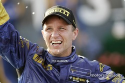 Podium: rally winner Petter Solberg celebrates