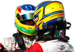Esteban Gutierrez celebrates victory in parc ferme with Roberto Merhi