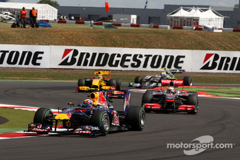 Mark Webber, Red Bull Racing leads Lewis Hamilton, McLaren Mercedes at the restart