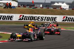 Mark Webber, Red Bull Racing leads Lewis Hamilton, McLaren Mercedes at the restart