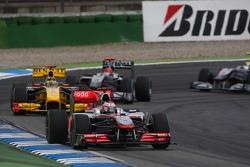 Jenson Button, McLaren Mercedes leads Robert Kubica, Renault F1 Team