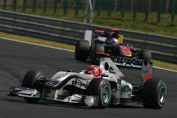 Michael Schumacher, Mercedes GP leads Sebastien Buemi, Scuderia Toro Rosso