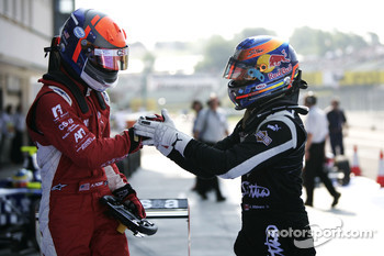 Alexander Rossi celebrates vicotry in parc ferme with Robert Wickens