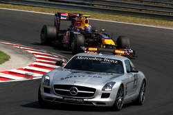 The safety car leads Mark Webber, Red Bull Racing