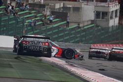 #12 Mad-Croc Racing Corvette Z06: Oliver Gavin, Pertti Kuismanen spin in front of #22 Sumo Power GT Nissan GT-R: Warren Hughes, Jamie Campbell-Walter