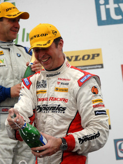 Matt Neal sprays champagne