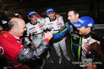 Overall and LMP1 class winners Stéphane Sarrazin, Franck Montagny, Pedro Lamy and LMP2 class winner Simon Pagenaud are congratulated by Dr. Wolfgang Ullrich, Head of Audi Sport