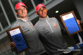 Jenson Button, McLaren Mercedes and Lewis Hamilton, McLaren Mercedes, hand printing session