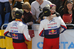 Winners Sébastien Loeb and Daniel Elena, Citroën C4, Citroën Total World Rally Team, celebrate with their family
