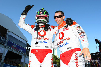 Jamie Whincup and Steve Owen celebrate victory after taking out race two of the Gold Coast 600 for TeamVodafone