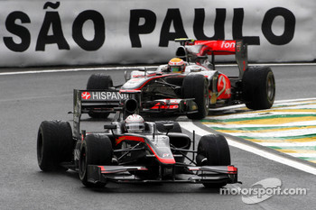 Christian Klien, Hispania Racing F1 Team leads Lewis Hamilton, McLaren Mercedes