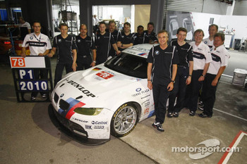 LMGT2 class winners Jörg Müller and Dirk Werner celebrate with BMW Team Schnitzer team members