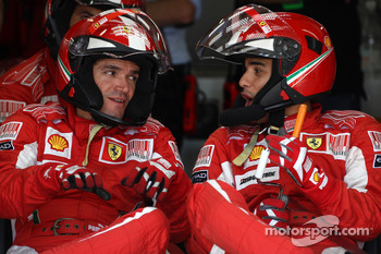 Ferrari mechanic watch the race