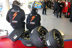 Team members for Robby Gordon wait during practice