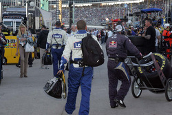 Crew members for Jimmie Johnson walk down pit lane after they had been replaced with Jeff Gordon's crew