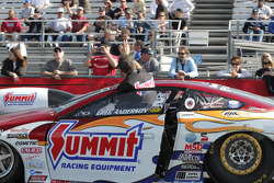 Greg Anderson waving to fans in his Summit Racing Pontiac GXP