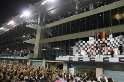 Podium: race winner and 2010 Formula One World Champion Sebastian Vettel, Red Bull Racing, celebrates with second place Lewis Hamilton, McLaren Mercedes, Sebastian Vettel, Red Bull Racing