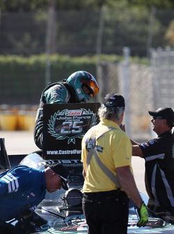 John Force exiting his Castrol Ford Mustang after defeating former team mate Gary Densham in Round 1 of the Auto Club NHRA Finals