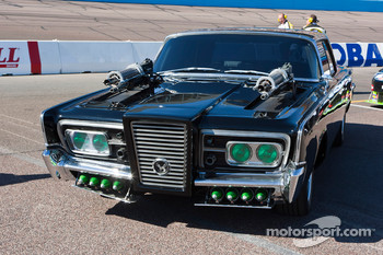 The Green Hornet Chrysler Imperial sits on pit road