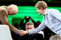 Niki Lauda, consultant David Coulthard and Sebastian Vettel