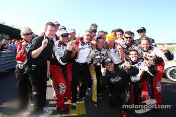 James Courtney celebrates victory with his team
