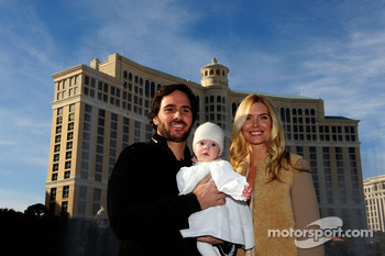 Five-time NASCAR Sprint Cup Series Champion Jimmie Johnson, his daughter Genevieve Marie and his wife Chandra pose outside the Bellagio Hotel and Casino Resort