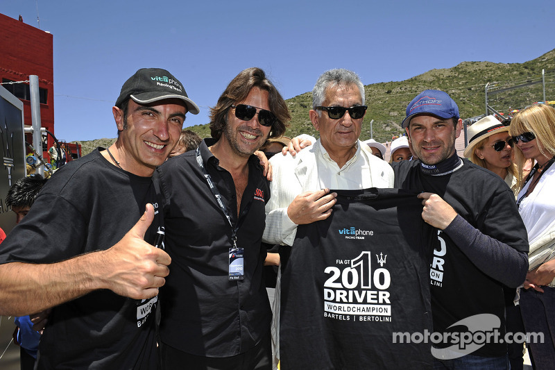 2010 FIA GT1 World champions Andrea Bertolini and Michael Bartels celebrate with Stéphane Ratel, Chairman of SRO, and Alberto Rodriguez, SAA Governor of San Luis Province