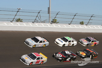 Kurt Busch leads a group of cars