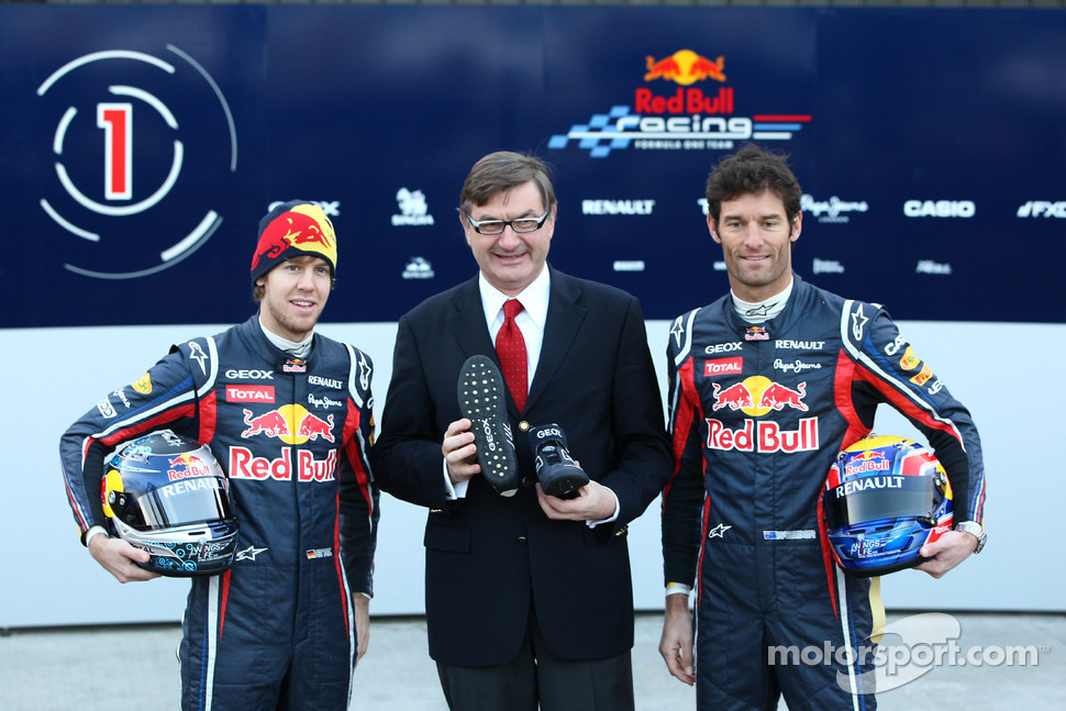 Sebastian Vettel Red Bull Racing with Mark Webber, Red Bull Racing and a representative of GEOX