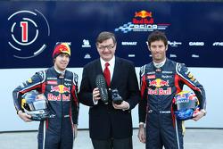 Sebastian Vettel Red Bull Racing with Mark Webber, Red Bull Racing and a representative of GEOX