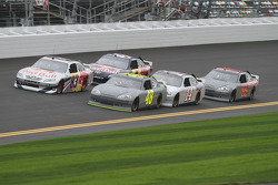 Brian Vickers, Red Bull Racing Team Toyota and Jimmie Johnson, Hendrick Motorsports Chevrolet lead a group of cars