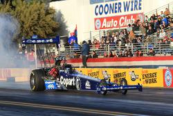 Brandon Bernstein doing a burnout aboard his Copart Top Fuel Drgaster