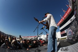 Country recording artist Jonathan Harris performing during pre race concert