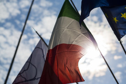 The flags of Monza, Italy and Europe