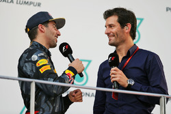 (L to R): Race winner Daniel Ricciardo, Red Bull Racing on the podium with Mark Webber, Porsche Team WEC Driver / Channel 4 Presenter