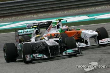 Nico Rosberg, Mercedes GP and Paul di Resta, Force India F1 Team