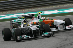 Nico Rosberg, Mercedes GP and Paul di Resta, Force India F1 Team