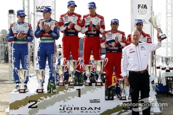 Podium: rally winners Sébastien Ogier and Julien Ingrassia, second place Jari-Matti Latvala and Miikka Anttila, third place Sébastien Loeb and Daniel Elena
