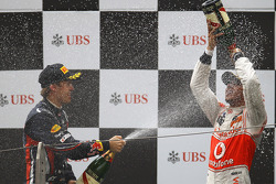 Podium: race winner Lewis Hamilton, McLaren Mercedes, with second place Sebastian Vettel, Red Bull Racing