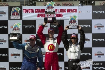 Podium: race winner Sbastien Bourdais with Paul Tracy and Bruno Junqueira