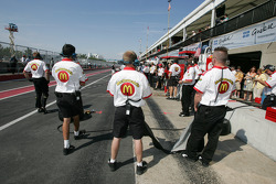 Newman Haas Racing crew members wait for Sébastien Bourdais