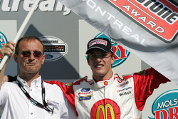 Pole winner Sébastien Bourdais celebrates with his dad Patrick