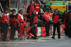 PKV Racing crew members wait for Jimmy Vasser