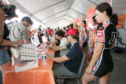 Fans and drivers at autograph session
