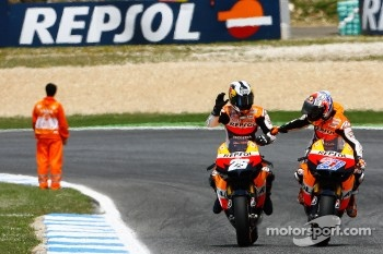 Race winner Dani Pedrosa is congratulated by teammate Casey Stoner