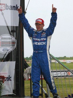 A.J. Allmendinger celebrates his victory