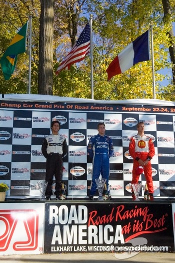 Podium: race winner A.J. Allmendinger with Bruno Junqueira and Sébastien Bourdais