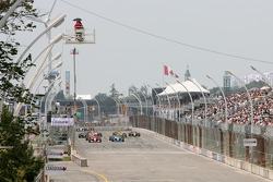 Justin Wilson leads the field to the green flag