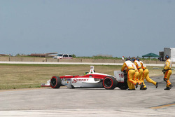 Champ Car safety officials tried to move the stalled car of Bruno Junqueira
